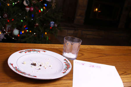 A plate of cookie crumbs left by Santa Claus with a tree and fireplace. Stock Photo - 16741646
