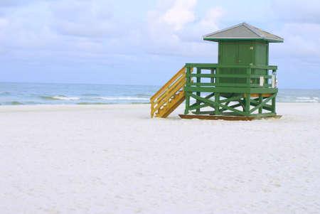 A green lifeguard hut on an empty morning beach        Stock Photo