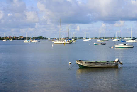 Boats at anchor in a calm bay Stock Photo - 17421311