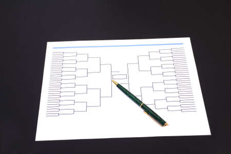 A pen on top of a blank March Madness tournament bracket
