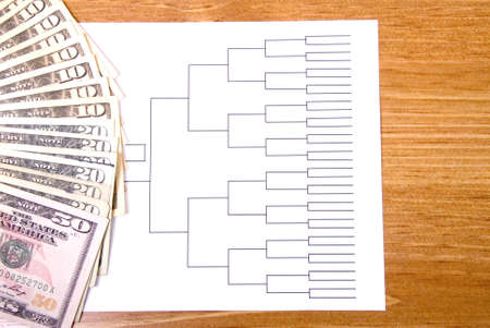 bracket: A basketball tournament bracket and fanned money
