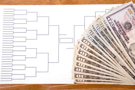 Blank tournament bracket with fanned money representing gambling photo