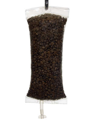 iv bag: Full frame image of coffee beans in an IV bag as a metaphor for Coffee as a drug. Stock Photo
