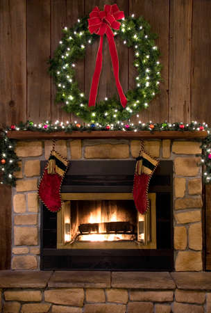 stone fireplace: Two Christmas stockings hanging by the fireplace.