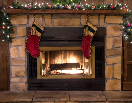 stone fireplace: Christmas stockings hanging over the fireplace hearth.