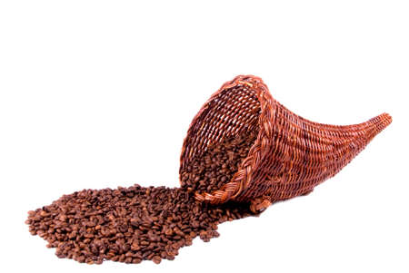 A wicker cornucopia full of coffee beans.