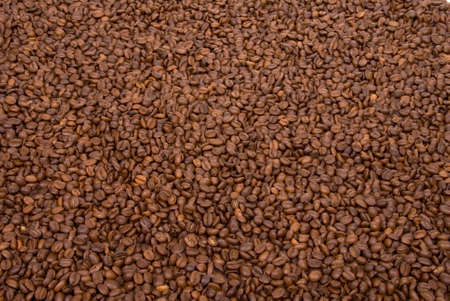 Background image of hundreds of coffee beans. Stock Photo