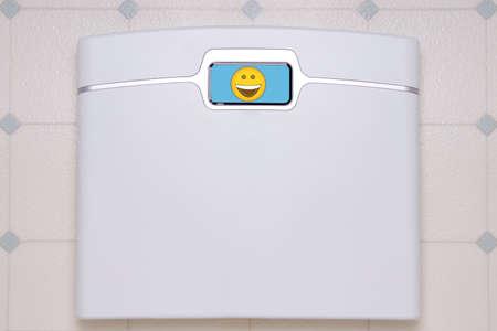 A white, digital bathroom scale displaying a happy face emoji.