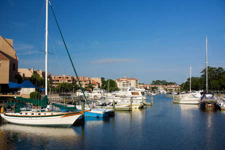 sc: Boats in a canal in Shelter Cove in Hilton Head, SC.