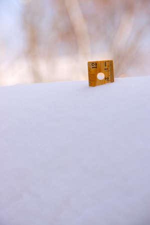 A ruler showing a deep snowfall in winter. Stock Photo