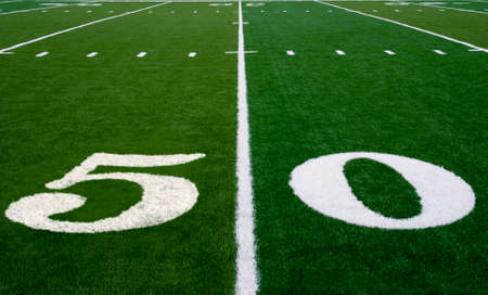 a field: 50 yard line on an american football field Stock Photo