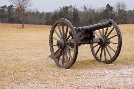 A Civil War cannon in a cold field