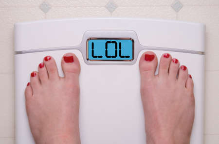 Digital Bathroom Scale Displaying LOL text