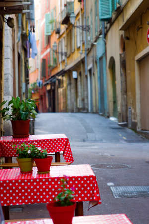 Two dining tables in adeserted European street