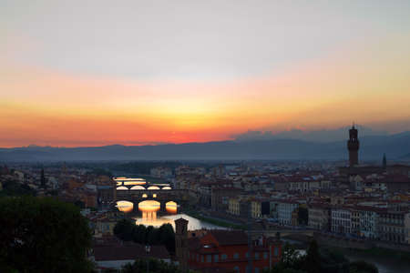 Sunset over Florence, Italy reflected in the Arno River.
