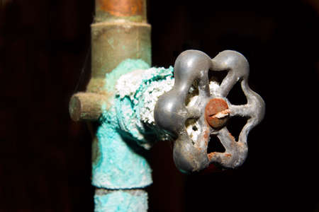 An old corroded rusty plumbing valve. Better call the plumber!