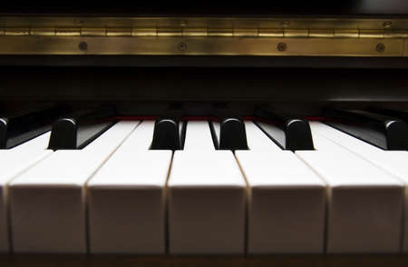 acoustically: detail of piano keyboard, key, melodic, creative
