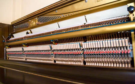 upright piano: view from the mechanism of an  upright piano Stock Photo