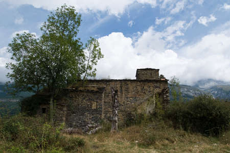 without windows: view of an old house without windows, with a tree beside a landscape in Pyrenees, Spain