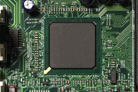 Close-up of microprocessor chip on motherboard in computer. Stock fotó