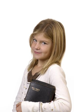 cousin: Young girl in studio in Bible looking at camera. Stock Photo