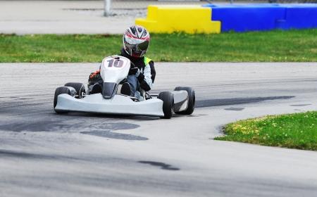 kph: Teenage racer on a Yamaha engined sprint kart on a road racing circuit