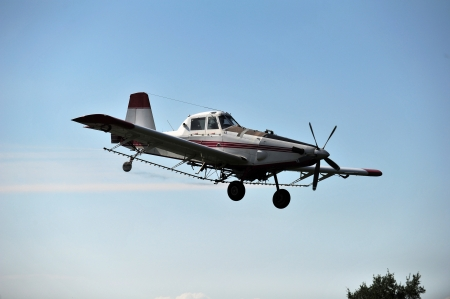 ag: Cropduster spraying soybeans in the summer in rural Indiana, USA