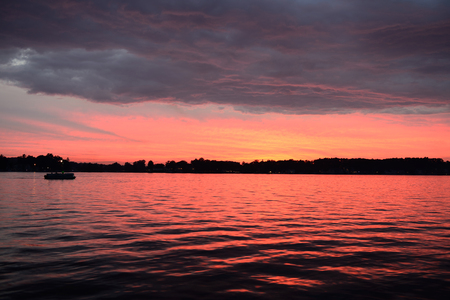 lakefront: Evening colors and clouds over Lake James in Angola, Indiana USA. Stock Photo