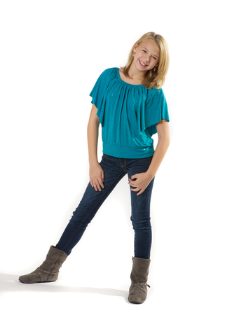Tween girl standing and smiling.