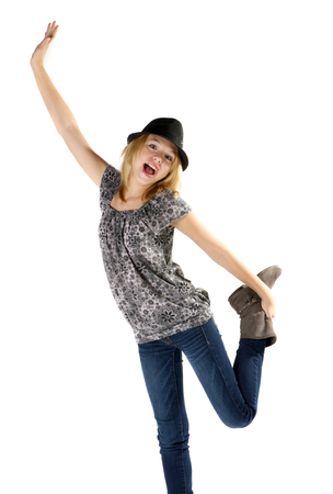 Tween girl with hat jumping.