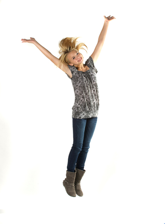 Tween girl jumping over white. Stock Photo