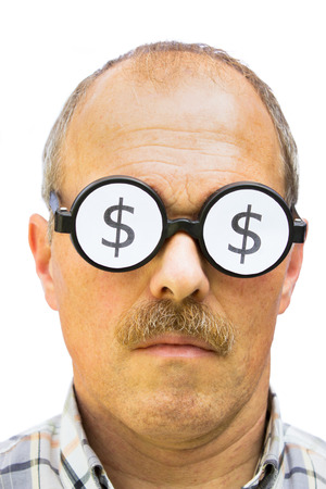 wearing spectacles: Man wearing spectacles with dollar signs on his glasses