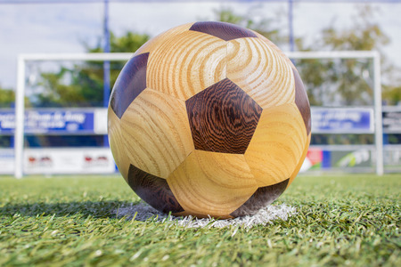 wood turning: football lying on penalty spot with goal in background