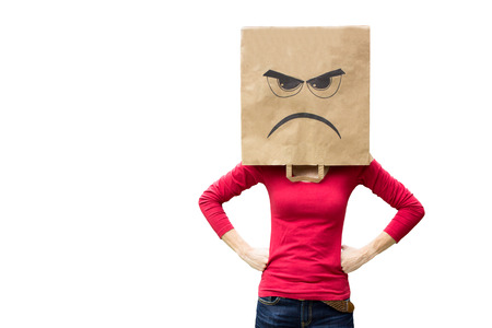 Angry woman wearing paper bag showing facial expression of frustration Stockfoto