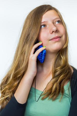 Blonde caucasian teenage girl phoning with mobile telephone Standard-Bild