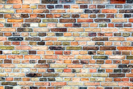 stacked stones: Brick wall of house with various colors