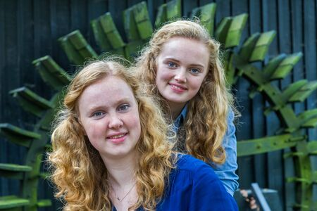water mill: Two european teenage sisters in front of water mill
