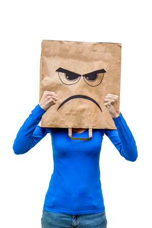 convinced: Angry woman with frustrated expression on paper bag showing fists Stock Photo