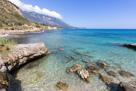 kefallinia: Landscape coast with blue sea rocks and mountains in Greece Stock Photo