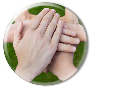 joining together: Hands uniting joining together in glass sphere isolated on white background