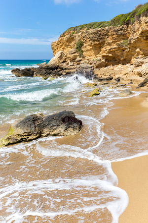 Landscape in Kefalonia Greece with mountain rocks and waves of sea
