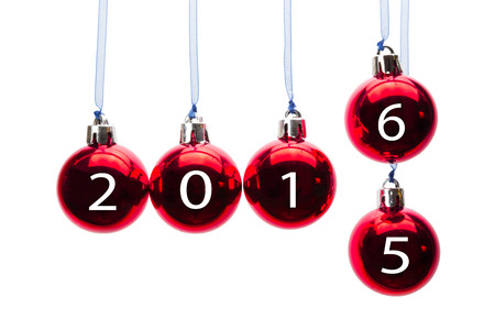 successively: Red christmas balls or baubles  with numbers of old year 2015 and new year 2016 isolated on white background Stock Photo