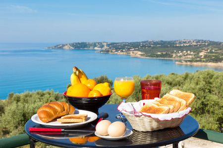 kefallinia: Table with food and drinks in front of sea on island Kefalonia in Greece