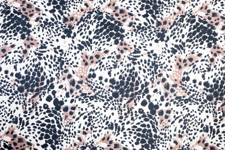 Background or backdrop of black spotted animal fur print
