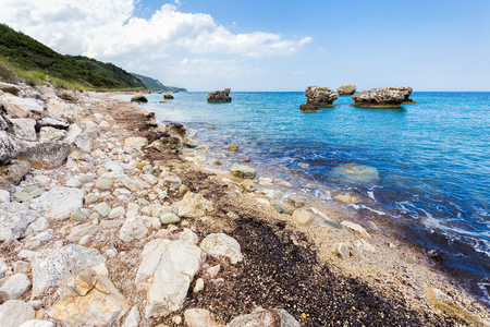 kefallinia: Landscape with boulders and rocks on coast with blue sea Stock Photo