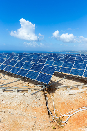 moveable: Many rows of blue solar collectors near sea at coast in Greece with blue sky Stock Photo