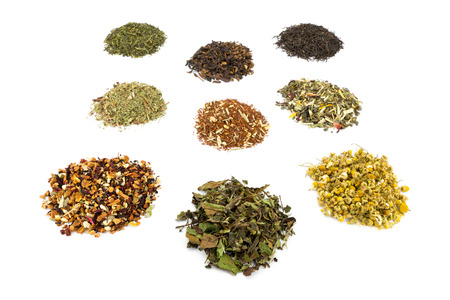 tastes: Various heaps and tastes of tea isolated on white background