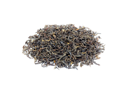 assam tea: Heap of loose black tea Assam isolated on white background