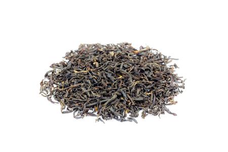 assam tea: Heap of loose black tea Assam isolated on white background