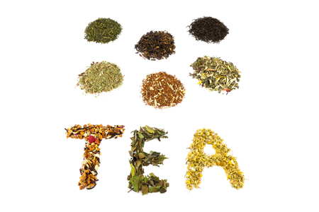 green herbs: Word TEA with various flavors and tea species isolated on white background